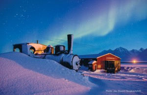 Cool spot: The building where Ms Travers worked and its backdrop – the Northern Lights, or Aurora Borealis. Pictures: Jan Sivert Hauglid