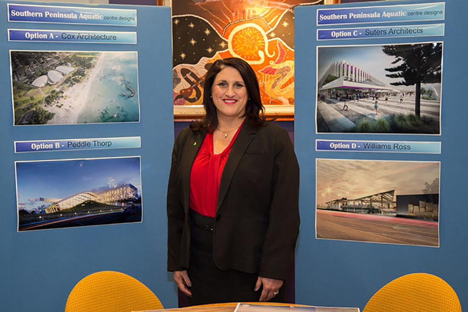 Final phase: Shire mayor, Cr Antonella Celi, unveils the four designs drawn up for the Southern Peninsula Aquatic Centre, which are now on public display. The community is being invited to help select the winning design.