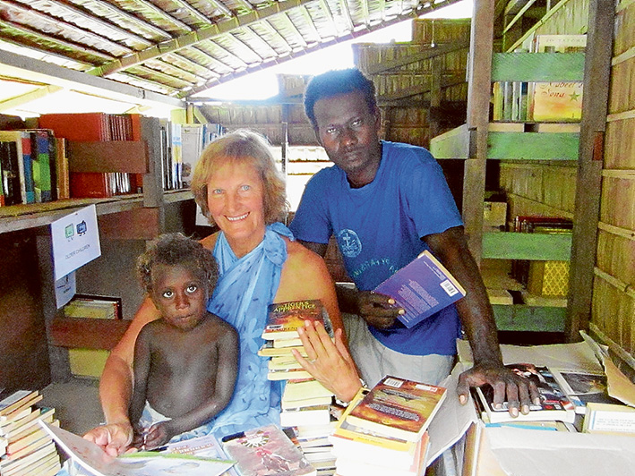 Water on tap: Sue Smith in the Lokuru community library, Rendova Island with Jackson Quavo, of Mile 6, who is helping Sue with the Water is Life project.