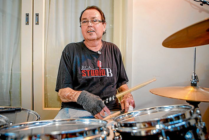 The beat goes on:  John Wells has defied the odds to survive throat cancer and is back on the road starring in tribute shows to Roy Orbison and The Eagles.  Pic: Gary Sissons
