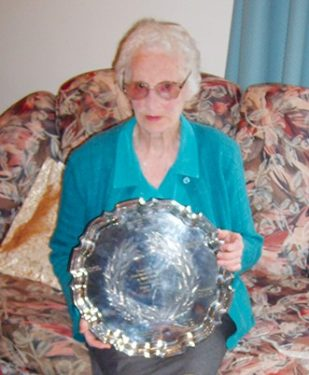 Above: Eileen at 95 with the tray presented to Norm on completion of 50 years of service to the Hastings Football Club