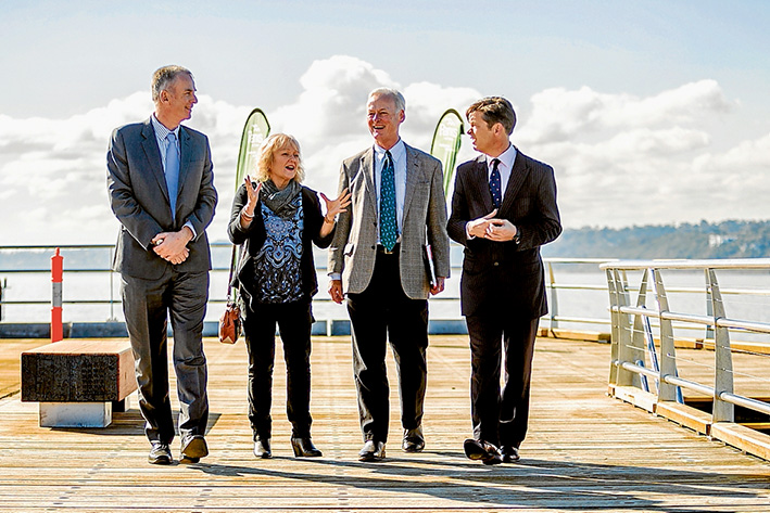 Peer talk: On the almost-completed Mornington pier last week are, from left, acting Parks Victoria CEO Chris Rose, Mornington Peninsula Shire mayor Cr Bev Colomb, Parks Victoria board chairman Andrew Fairley and Ports Minister Luke Donnellan. Labor and Liberal governments have put almost $19 million into rebuilding the structure over five years. Picture: Yanni