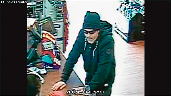 Caught on film: A still image of the man police with to speak to about the liquor outlet robbery.