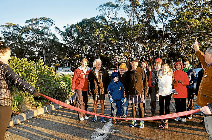 Summit start: Greg Hunt and supporters set off from the top of Arthurs Seat to walk 500 kilometres around his electorate, raising money for charity and awareness of autism. Picture supplied