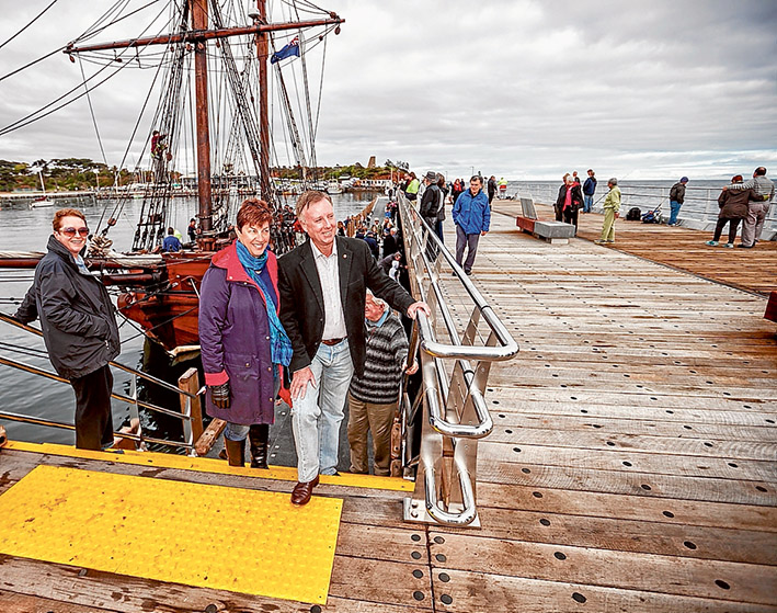 """Mission accomplished: Mornington MP David Morris, left, was at the pier with his wife Linda to celebrate the completion of a """"bungled"""" project which was re-started when he was part of the Liberal-Coalition government. Also trying out the new pier are Neil and Linda Sanddington, above, with pugs Ava and Theo. Pictures: Yanni"""
