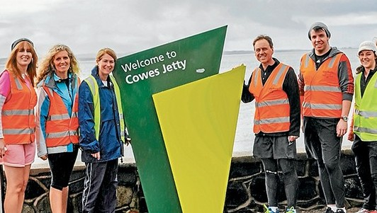 Walk's end: Flinders MP Greg Hunt, centre, at Cowes jetty on Friday with some of the people who joned and supported his walk, including, Bass Coast Shire mayor Kimberley Brown, Marilyn Myszka,  and members of his staff Christian Lee and Samantha Robin.