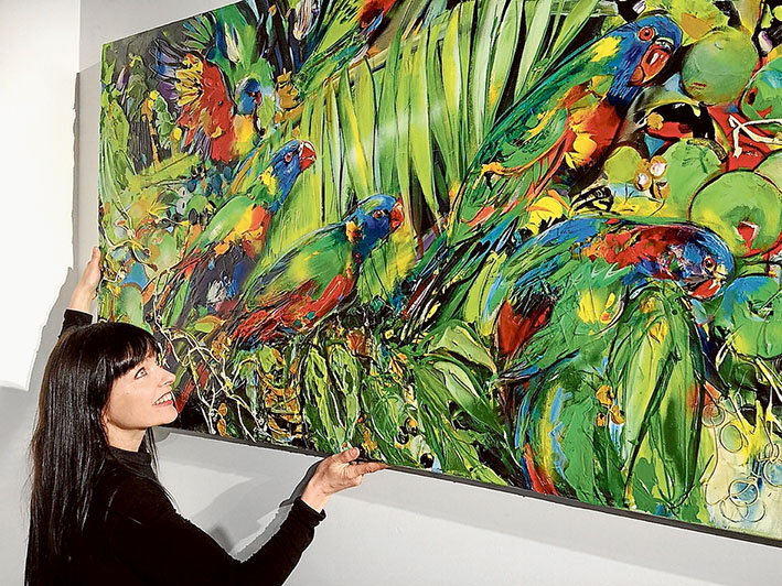 Hanging day: Rebecca Davy hangs a painting by Gail Rutland Gillard at the revamped Noels Gallery, 1175 Mornington-Flinders Rd, Red Hill.