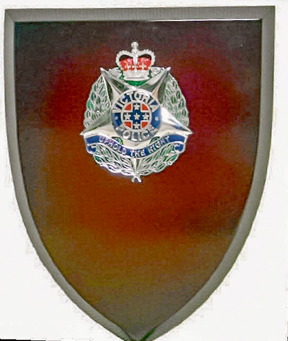 Personal value: The Ty-Eyre plaque stolen in the raid was awarded to Lloyd Smith for helping police investigate the brutal slaying of two young constables.