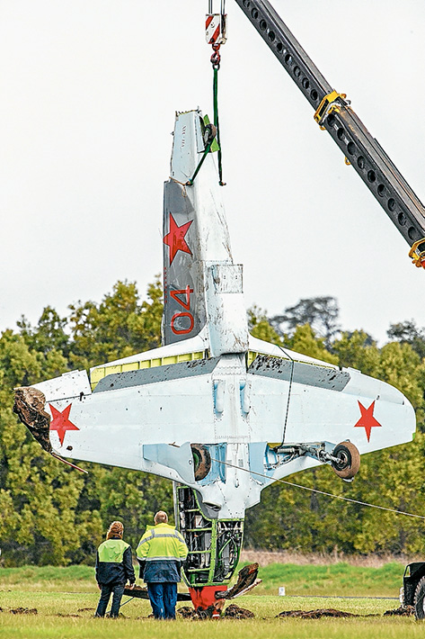 Off runway: The Yak 9 which flipped after landing at Tyabb airfield on Sunday. No one was injured in the crash. Pictures: Gary Sissons