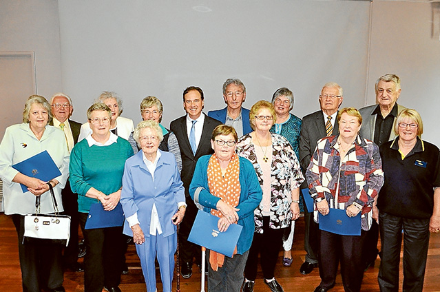 Stalwarts: Fourteen of the 15 recipients of 2015 Flinders Seniors Awards with Flinders MP and environment minister Greg Hunt (centre back row in suit). Picture supplied