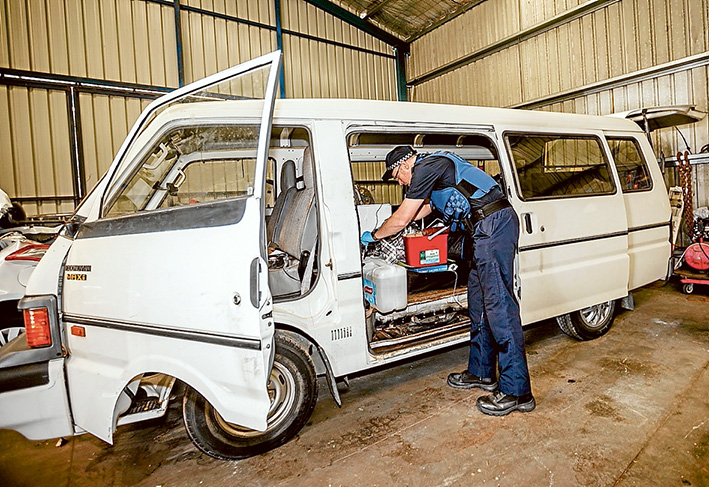 Telltale signs: Somerville Senior Constable Dave Taylor dusts the caravan for fingerprints.