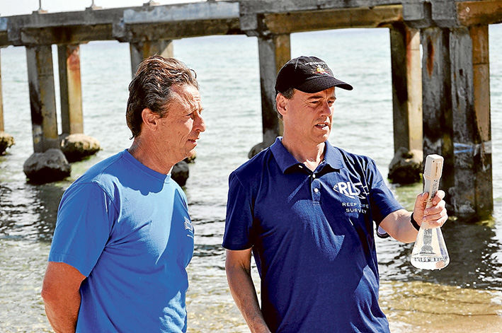 Testing time: Greg Hunt and Clean Ocean Foundation's John Gemmill show how water samples can be tested. Picture: Supplied