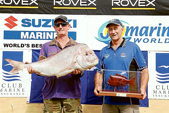 New champion: John Close's 12.07 kilogram snapper in this year's Snapper Point Angling Club's Tea Tree competition earned him the state titles. He is pictured, left, with Theo Hatzis who came second with a 10.11kg fish.