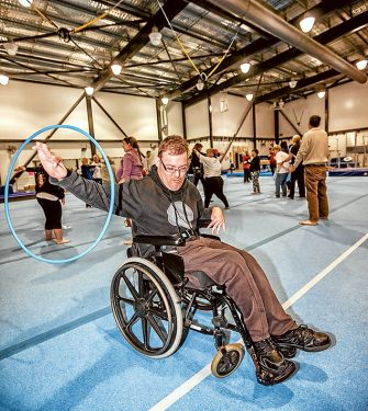 Action for all: Marcus Watson spins the hoola hoop while Connor, of the Nepean School, tries table tennis with help from his carer, Robyn. Pictures: Yanni