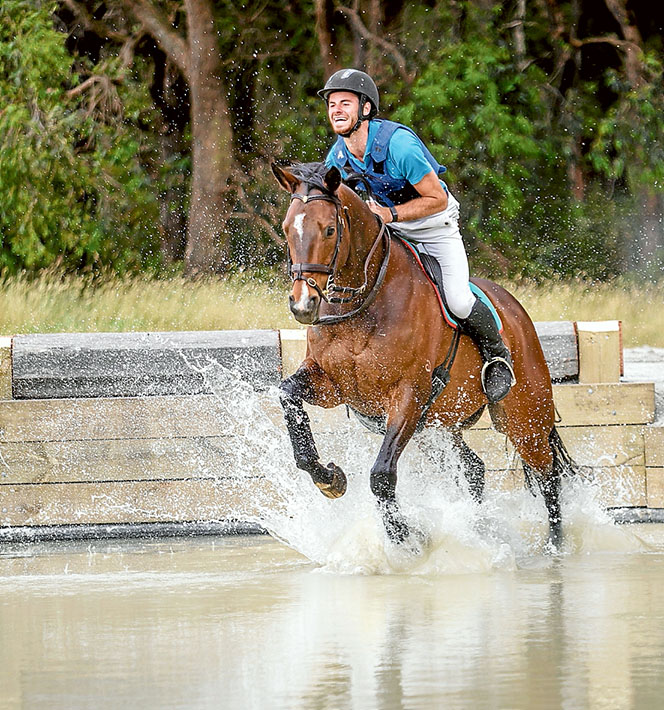 Splish, splash: Charlie King puts Jag through his paces at the new water jump complex at Main Ridge. Picture: Yanni