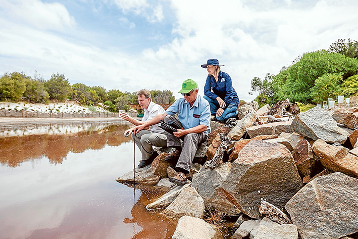 Gassed up: Mornington Peninsula Shire's senior environmental health officer Peter O'Brien, Geoff Hall, of Estuary Watch and Joanne Thom, of Melbourne water, monitor hydrogen sulphide gas levels in Merricks Creek. Picture: Yanni