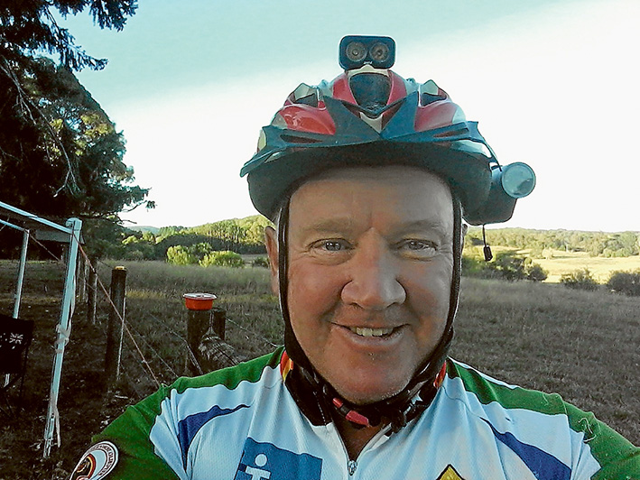 Helmet with benefits: George Paterson has fitted lights and a camera to his bike helmet to alert and monitor motorists.