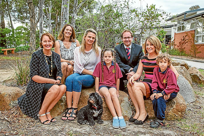 New course: Judith Couacaud Graley, Kath Lord, Jasmine Kennedy, Daniel Mulino, Beverly Dadds and pupils Josie and Joshua at Mornington Park Primary School for the announcement of a mentoring program. (The dog Pepe is the school's therapy dog) Picture: Gary Sissons