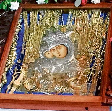 Items found: The Virgin Mary icon and pieces of jewellery found after being dumped on the side of the road.