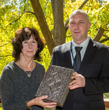 Happy returns: Robbery victim Maree Brann and Detective John Melhuish with the recovered jewellery box. Picture: Gary Sissons