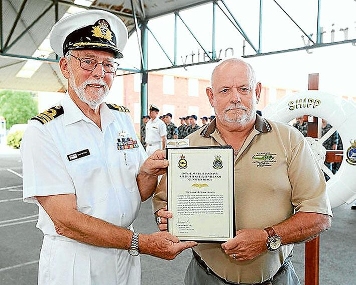 Time heals: Vietnam Veteran Able Seaman Rtd Ian Wilson receives his Helicopter Flight Vietnam Gunner Wings from Commander Max Speedy (ret), during a ceremony at HMAS Cerberus last week.
