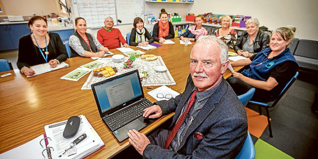Improving literacy: Richard Mucha and the principal team from Hastings primary schools get together regularly to talk about linking literacy and learning. Picture: Yanni