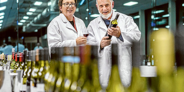 Class of their own: Head steward Phyllis Scales and International Cool Climate Wine Show chairman Kevin Wyatt taste their way through the classes of wine entered in this year's show Mornington Racecourse last week. Picture: Gary Sissons