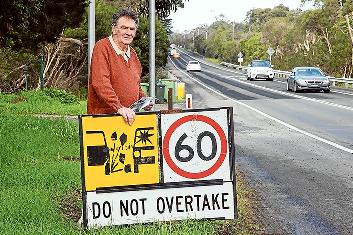 Under repair: Gordon Turner is angry at the state of the busy Frankston-Flinders Rd near the Baxter turnoff at Hawkins Rd.    Picture: Gary Sissons