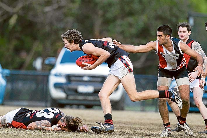 Double trouble: Frankston Bombers overcame Devon Meadows, beating them 88 points to 44. Picture: Scott Memery
