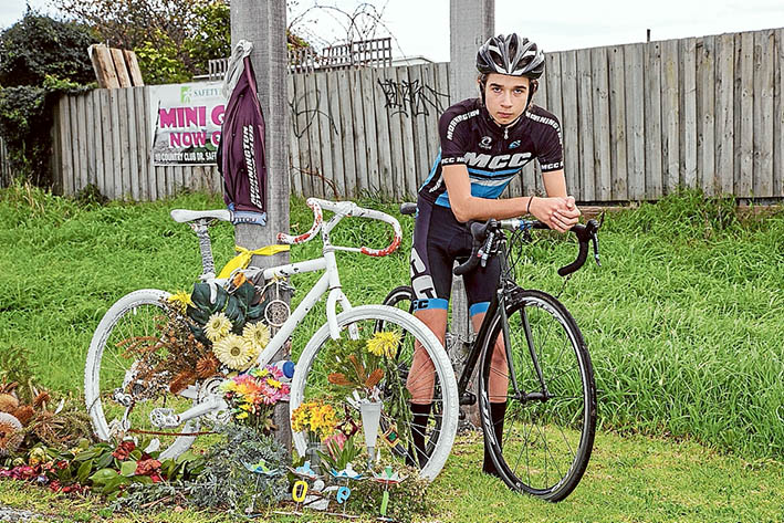 Riding on: Sam Turner, beside the Ghost bike memorial to Joel Hawkins, is determined to live up to his friend's high standards. Picture: Gary Sissons