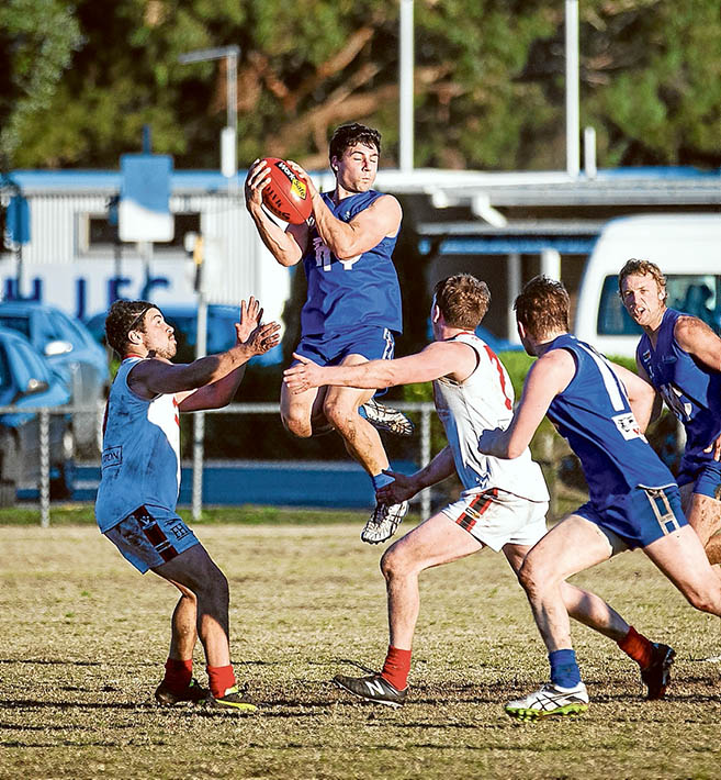 It's mine!: Despite the home ground advantage, Hastings went down by 26 points against Red Hill. Picture: Andrew Hurst