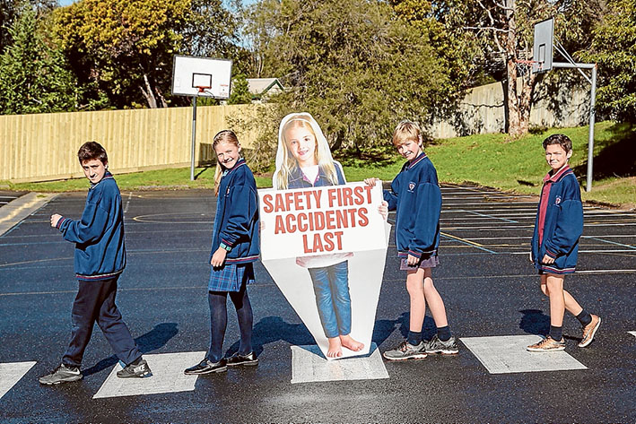 Read all about it: St Thomas More Primary pupils show off their winning signs in Canadian Bay Rd, Mt Eliza. Picture: Gary Sissons