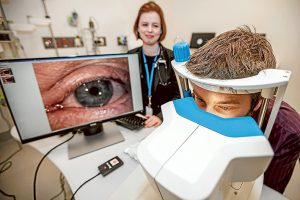 Sight seeing: Dr Sara MacKenzie watches on as Peninsula Health systems officer Terry Crossin looks at a new eyePressure device at Frankston Hospital. Picture: Yanni