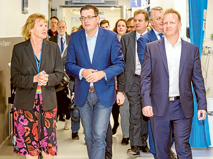 Suicide not painless: Frankston Hospital CEO Sue Williams, left, gives Premier Daniel Andrews and MP Paul Edbrooke, right, at Frankston Hospital last week. Picture: Yanni