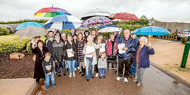 Too many units: Mt Martha residents opposed to a high density housing development brave the elements to show their opposition. Picture: Yanni