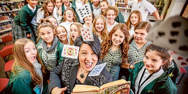 Living library: Magician Cath Jamison shows off her skills as one of the world's foremost female magicians to Rosebud Secondary College students. Picture: Yanni