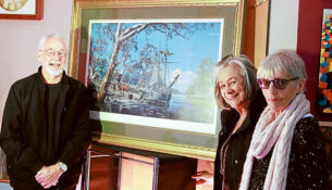 """Master marine artist: Richard Linton, pictured with a print of his painting """"The Founding of Melbourne"""", and The Crib 2018 Arts Studio owner Norma Carew, and studio supporter Shirley Butler. Picture: Cameron McCullough"""