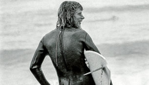 """Top rider: Bernard """"Midget"""" Farrelly, above, at Bells Beach in the mid-1970s and,  below, with Doug """"Claw"""" Warbrick one of the founders of Rip Curl and, bottom, cutting an occy strap to open the 1975 Surfworld exhibition with the Skyhooks frontman, the late Graeme """"Shirley"""" Strachan. Pictures: Keith Platt"""
