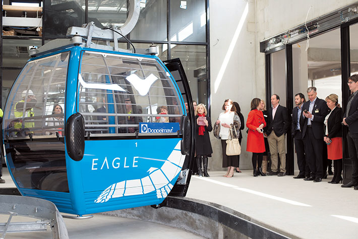 Top station: Invited guests take a close up look at one of the newly named Eagle gondolas which will soon be running up and down Arthurs Seat. Picture: Jarryd Bravo