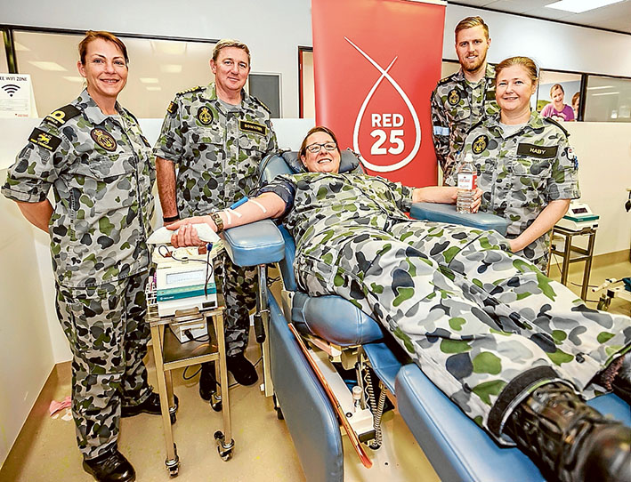 Bleeding by example: Sub Lieutenant Katherine Mulheron, Captain Stephen Bowater, Leading Seaman Jordan Manie and Able Seaman Debbie C Haby support Commander Melanie Verho as she gives blood. Picture: Yanni