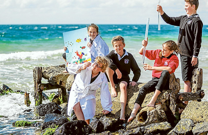Testing the water at Point Nepean as part of a project on Queensland's Great Barrier Reef are, from left, Matilda, Xaivea - Jae, Vance, Samantha and Ben. Picture: Yanni