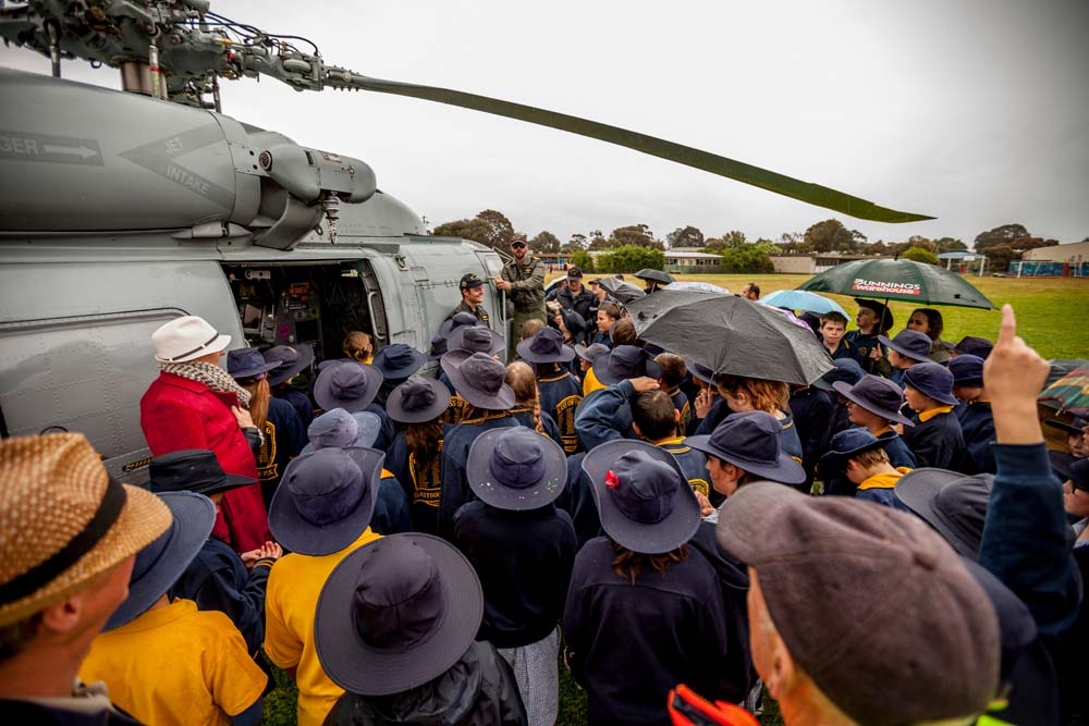 Inspiring message: Eastbourne Primary pupils flock to the helicopter from HMAS Cerberus. Pictures: Yanni