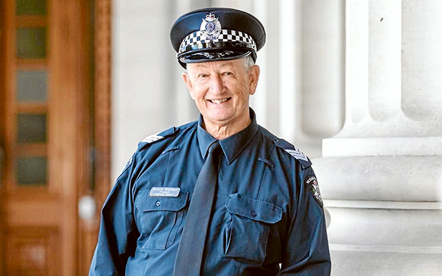 All smiles: Sergeant Bruce Buchan looks back on a career of service as part of the Victoria Police force.