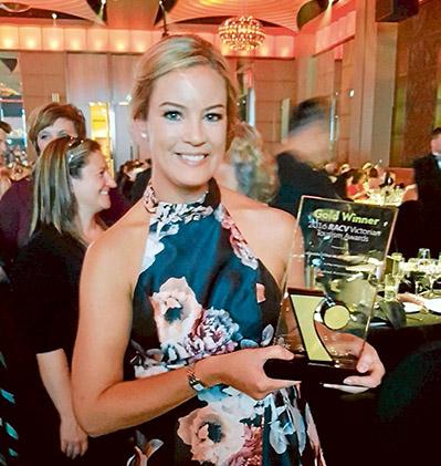 Prized possession: Linda Crittenden from Lakeside Villas at Crittenden hugs her gold award.