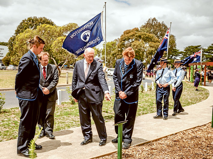 THE Governor-General Sir Peter Cosgrove is shown the path at the centre of a new avenue of honour that has been planted at Mornington Secondary College. Pictures: Yanni