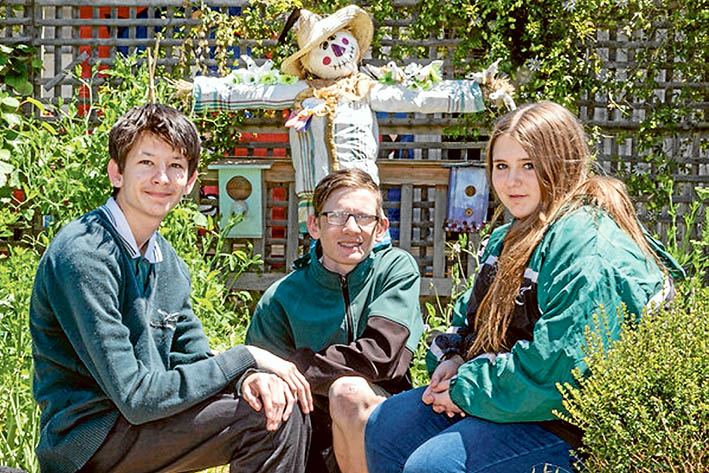 Flinders the Scarecrow shows that gardens provide food, shelter and beauty. Time spent in the garden is never time wasted, according to Jackson, Matt and Simone. Pictures: Gary Sissons